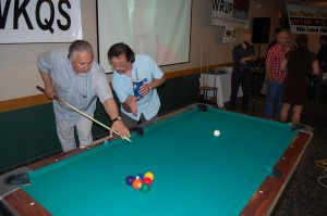 Dennis Shownig Walt Lindala some pool moves at Rec Depot Pool Table Giveaway