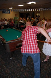 Todd Noordyk Giving Pool Tips to Cora Bleau, the 3rd Finalist in the Rec Depot Game Room (pool table) Giveaway at the County Village Banquet & Convention Center