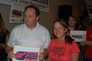 Sherry Warlin Stands Next to Joe Duckworth (WFXD 103.3 FM - The Country Extreme) at the Rec Room Game Room Giveaway - Ishpeming - July 12th