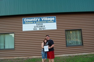 Dave Wiegand, Grand Prize Winner of the Rec Depot Game Room Giveaway, Under Country Village Sign