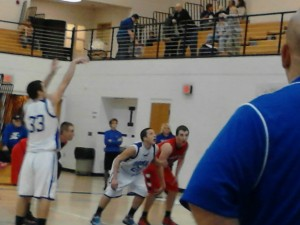 The Ishpeming Hematites in action against the Marquette Redmen