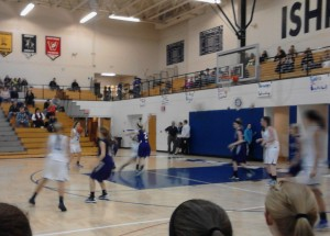 The Ishpeming Hematite Girls in action against the L'anse Purple Hornets