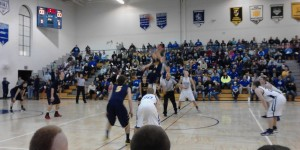 Tipoff starting the action between the Ishpeming Hematites and the Negaunee Miners tonight.