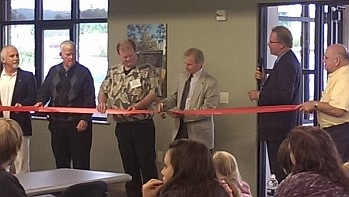 Randy Girard (3rd from right) cuts the Ribbon at the ALL NEW Marquette Township Offices on Commerce Drive!