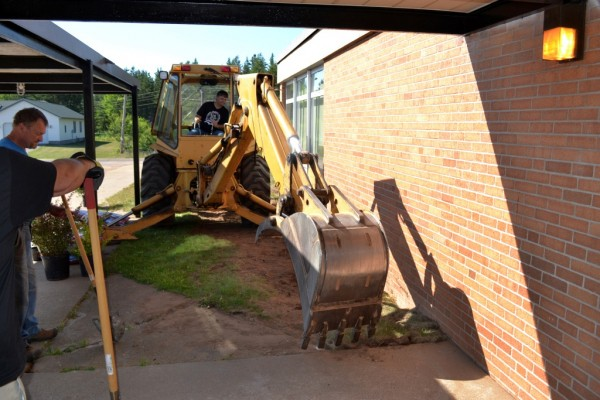 Volunteers Remove Old Cement From Entrance of Gilbert Elementary in Gwinn
