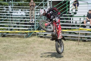 Jess Kempkes doing a motorsports show outside of the Livestock Barn at the MQT County Fair
