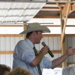 The fantastic 4-H Livestock Auctioneer at the Marquette County Fair 2015