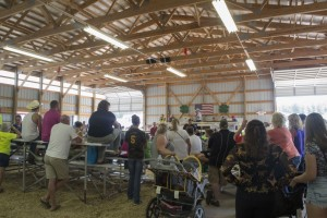 Crowds in the Livestock barn during the annual 4-H auction at the Marquette County Fair 2015