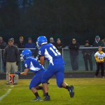 #12 running the ball with #4 bringing the defense!