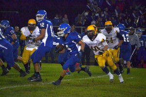 Ishpeming Varsity Football Player #4 making a great run on their home field