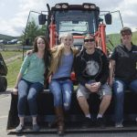 Cassidy, RiLee, Joe, and Paula on the front loader!
