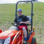 Andrew testing out the little tractor from Kioti/Ward's Outdoor Equipment and Repair