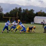 2016-ishpeming-hematites-negaunee-miners-varsity-football-Miners-runner-vs-Ishpeming-hematites-defense