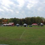The vendors getting set up on the practice field.
