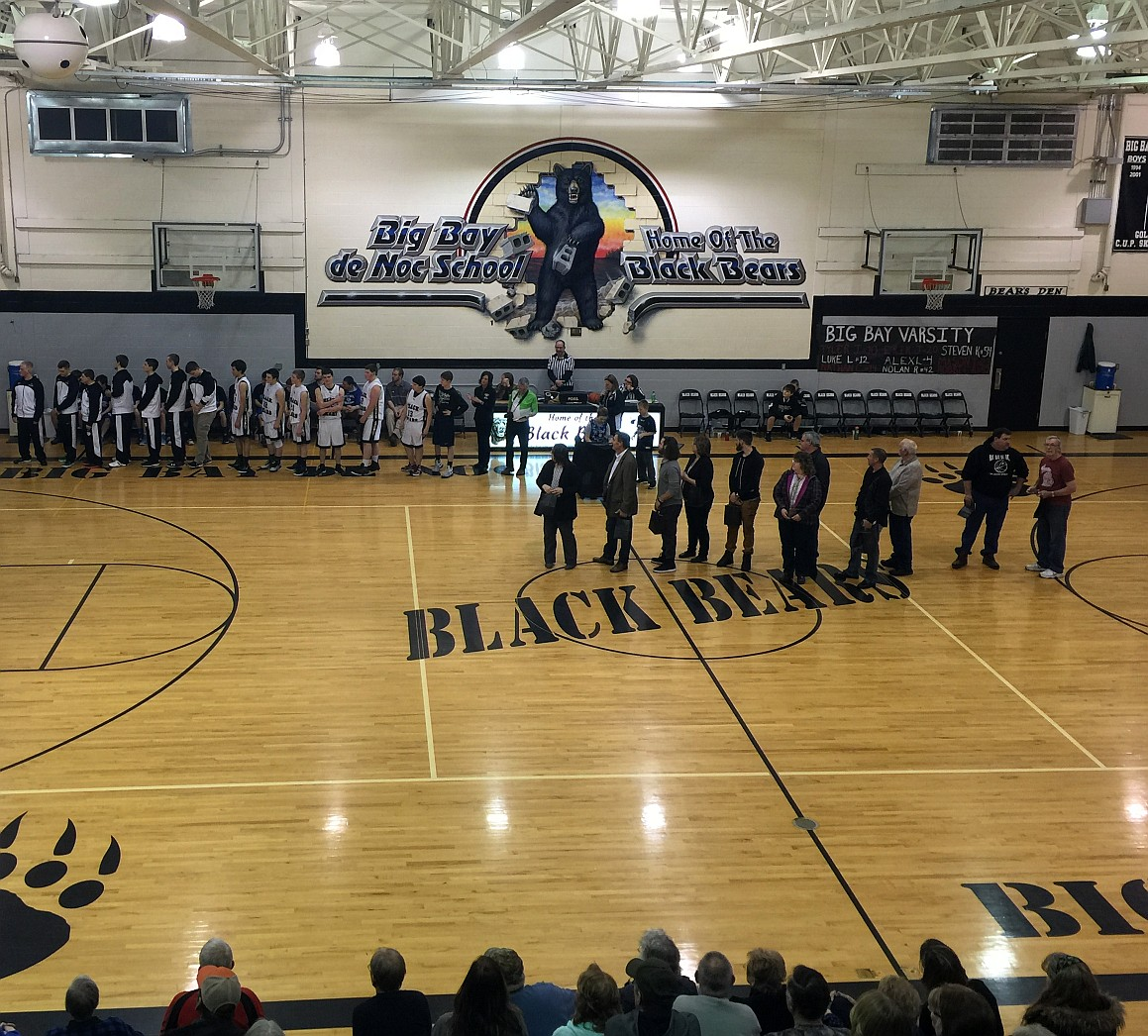 lining up on the court to be honored