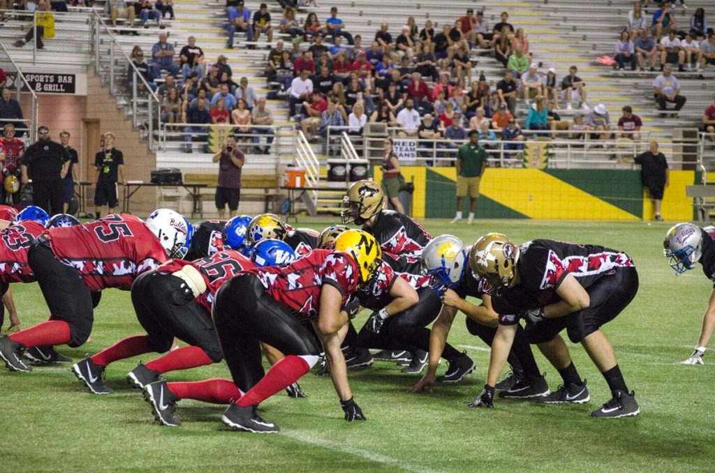 Black Team gets set to snap the ball.