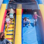 Kids tried to go down the slide in all different ways - feet first, head first, you name it, they tried it.