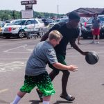 Some of hte NMU Men's Basketball players joined the fun to shoot some hoops with the kids.