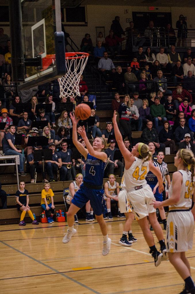 Ishpeming Hematites Girls with quick rebounds.