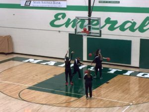 The Big Bay de Noc Black Bears girls warm up with hoops