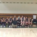 Big Bay de Noc Black bears Girls Basketball team on the bench