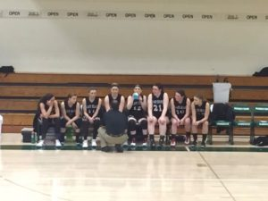 Big Bay de Noc Black bears Girls Basketball team on the bench