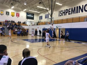 Ishpeming works the ball down low in a game they dominated all night.