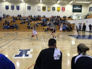 Chloe Sjoholm dribbles the ball up the court.