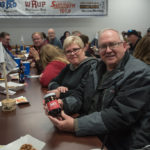 This couple gets to try a locally made BBQ sauce.