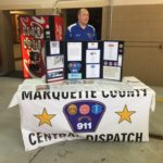 The Marquette County Central Dispatch had a booth too.