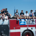 Ishpemings Track and Field team road on one of the fire trucks.
