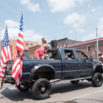 An all around symbol of America - Big trucks and American Flags.