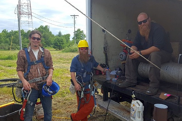 Joe, Tim and Luke at one of our towers repairing the antenna!