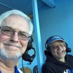 Mike and Bob get ready to watch a great game.