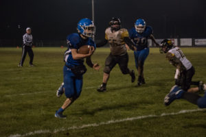 Gwinn defense moving in to tackle the QB.