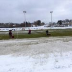 Community members donated their time to remove the snow from the field.