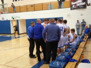 The Ishpeming Hematites in the huddle during their fourth quarter timeout against the Gwinn Modeltowners on 98.3 WRUP