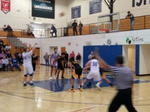A free throw attempt for the Ishpeming Hematites keeps their score close to the Modeltowners on 98.3 WRUP