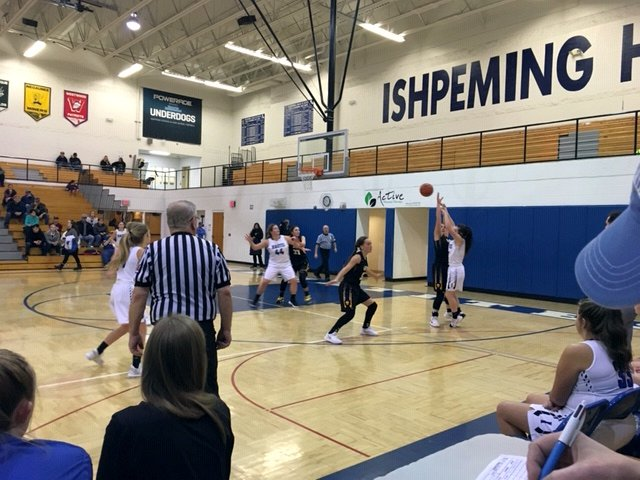 The Ishpeming Hematites putting up a shot against the tough Gwinn Modeltowners during a very close game on 98.3 WRUP
