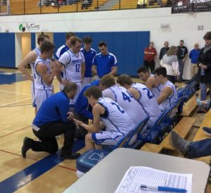 The Ishpeming Hematites receive some coaching advice in the second half during their game against the Negaunee Miners on 98.3 WRUP