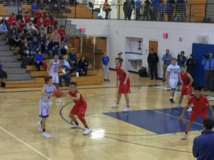 Your Ishpeming Hematites move the ball around during one of their possession against the Marquette Redmen on January 15th 2019 on 98.3 WRUP