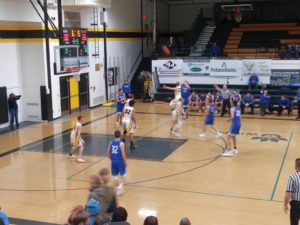The Ishpeming Hematites work the ball around the three-point line as time winds down against the Gwinn Modeltowners on 98.3 WRUP