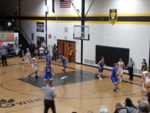 The Gwinn Modeltowners try and make a break for the basket against the Ishpeming Hematites