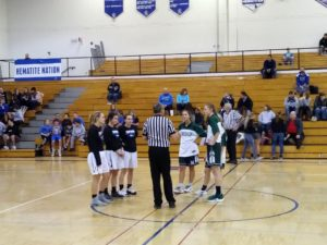 The Ishpeming Hematites girls basketball team watches the coin flip Friday night on 98.3 WRUP