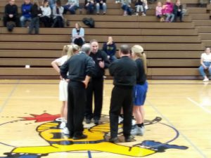 The Ishpeming Hematites and Negaunee Miners prepare to watch the coin flip during their game Monday night on 98.3 WRUP