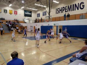 The Ishpeming Hematites drive toward the basket during their game against L'Anse on Monday