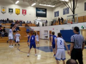 Ishpeming takes a three-point shot Monday night against the Calumet Copper Kings