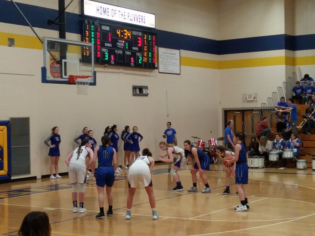 The Hematites shoot a free throw in their 56-36 loss against Kingsford on 98.3 WRUP.