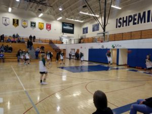 The Ishpeming Hematites girls warm up for their game against the Manistique Emeralds