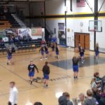 The Hematites warm up before their District semi-final game against the Gwinn Modeltowners.